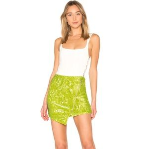 NBD Revolve lime green sequence skirt